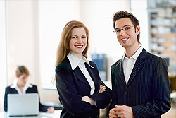 Male And Female Dressed In Business Attire