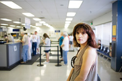 Female Waiting In Line To Speak With A Clerk