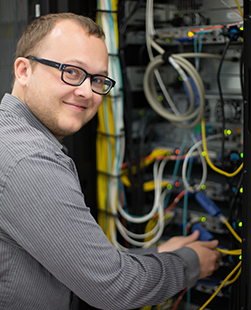 An electrical engineer monitoring a networking system