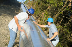 Two Engineers Examining Pipe