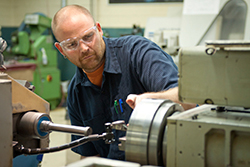 Professional Machinist with Saftey Glasses
