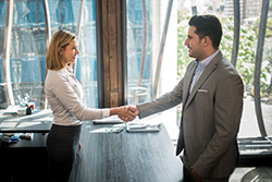 Handshake Between a Candidate and a Hiring Agency Representative