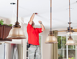 An Electrical Engineer Installing Light