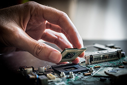 A Person Assembling a Circuit Board