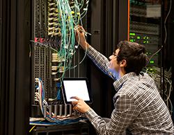 A Man Working On a Server