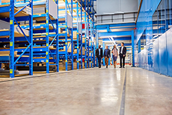 Two Men Walking in a Manufacturing Plant