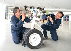 Aerospace engineers checking wheels of an aircraft