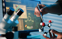 A Chemical Engineer Working on a Molecular Structure