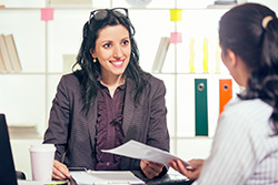 Smiling Woman Having Job Interviews With a Candidate