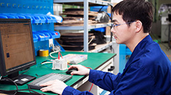 An Electrical PLC Programmer Working on a Machine Code