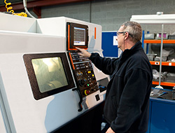 a CNC operator at work
